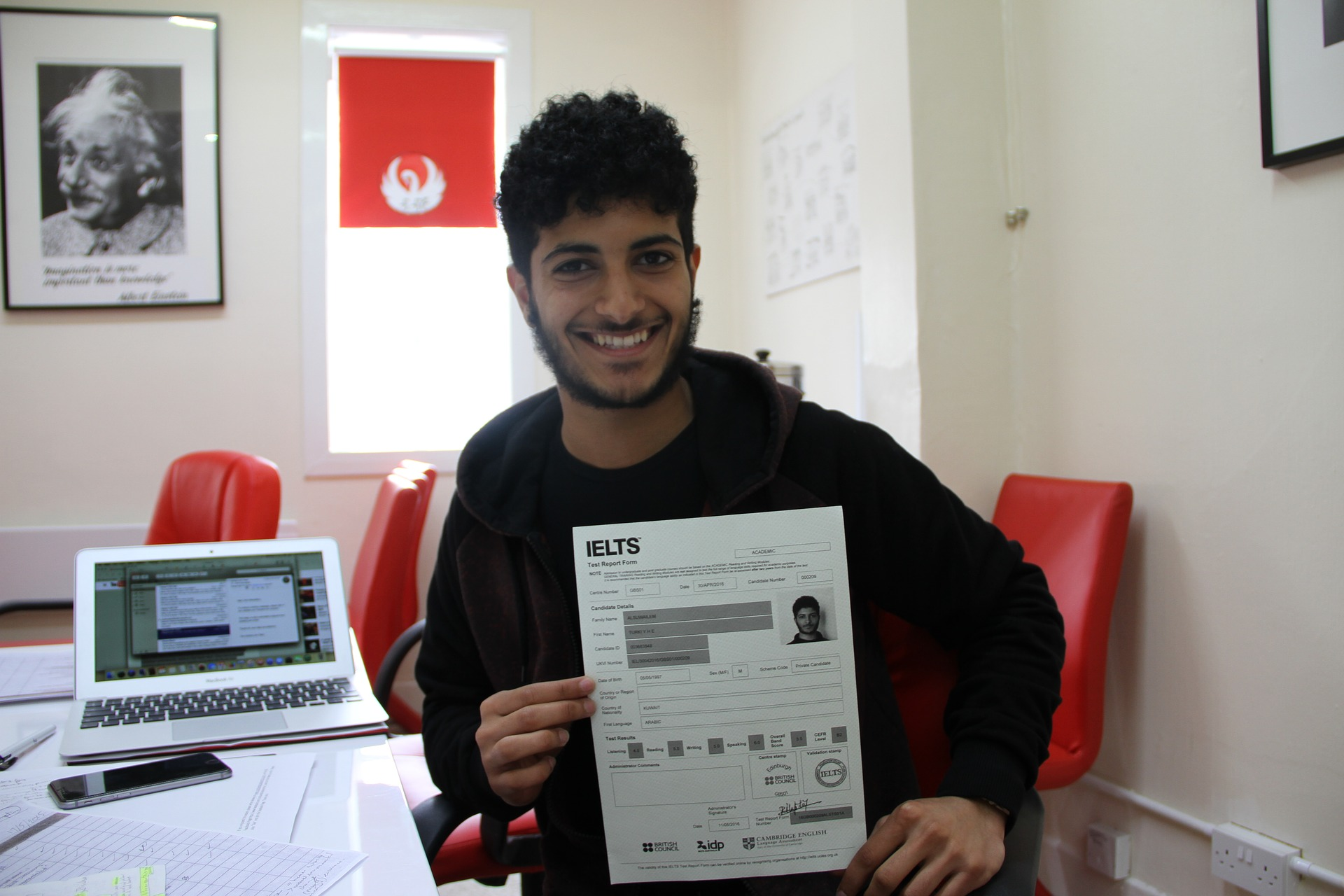 a boy with showing IELTS application form in hand