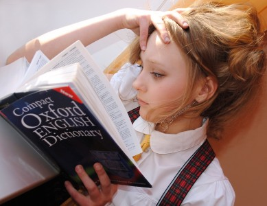 a girl reading igcse book