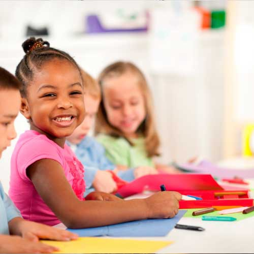 a kid smiling in the pre school class